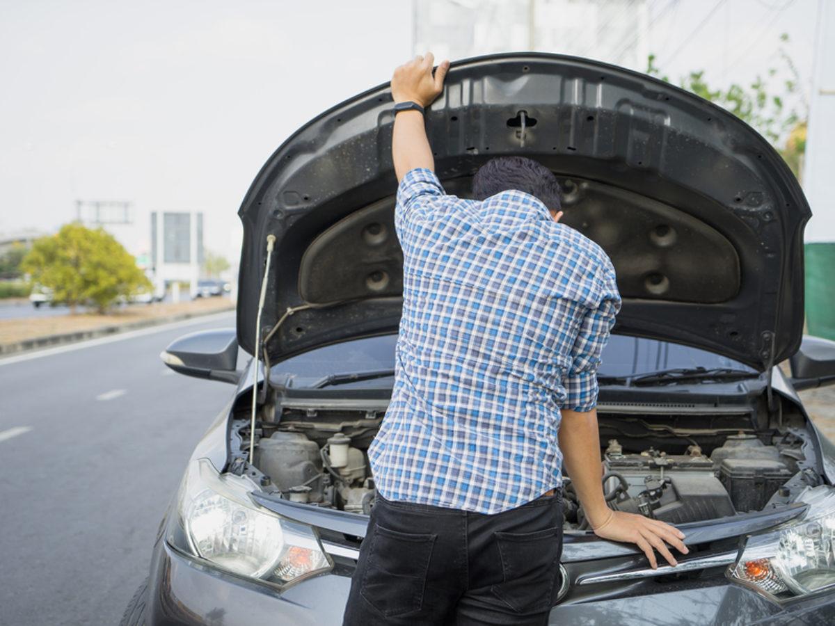 Mechanic Wearing Gloves Open Car Hood Checking Car Engine Oil On